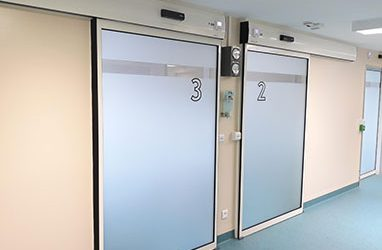 Doors with controlled leakage flow